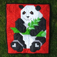 This panda quilt was made using batiks which makes a striking wall hanging, or a different fabric choice makes it a cuddly friend for your little one. * 3 sizes: Wall 24x28, Crib 36x42, and Lap 48x56 *Skill Level: Beginner   The pattern lists fabric yardage, then uses tables to show the number of strips to cut and the number of pieces to cut from those strips. The entire top is then sewn using straight 1/4 seams. The rounding is done with triangle overlays. *PDF format   You are ordering...