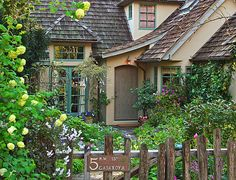"""The Fairytale Cottages of Carmel  """"May I a small house and large garden have, And a few friends, and many Books, both true, Both wise, and Both delightful too.""""  Abraham Cowler 1618-1667 English Poet"""