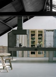 Another great kitchen with a light grey floor, I love the cabinets made out of reclaimed wood