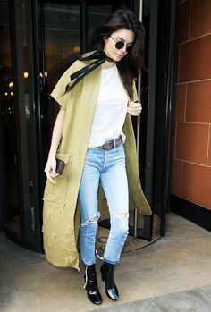 Kendall Jenner adds some edge to a white tee and jeans with a short sleeve coat and black patent boots