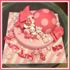 Candy christening pink cake