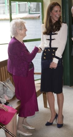 How cute is Kate Middleton? High waisted pencil skirt with buttons, white button down with nice blue details.