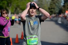 Description of . Pat Sullivan crosses the finish line to win the men's devision of the Colfax Marathon with a time of 2:40:47 of the 9th annual Colfax Marathon May 18, 2014. The 26.2 mile Marathon runs through Denver's iconic landmark Mile High Stadium (twice), Sloan's Lake, City Park, Colfax Avenue through Lakewood and Aurora. The Marathon started and finished in City Park where runners enjoyed the rest of the day listening to music by Chris Daniels and the Kings. (Photo by John Leyba/The…