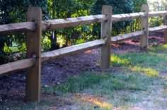 A split-rail fence is constructed using logs that have been split into rails.