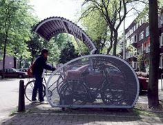 avecpleasure: The Fietshangar (bike hangar) fits well inside one car parking space and is designed to hold 5 bicycles, protecting them from theft and damage.