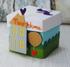I am Katie and am a Creative Designer for Sizzix. I specialize in papercraft design and love to create cards, home décor and scrapbook layouts. Creative Gift Wrapping, Creative Gifts, Real Estate Gifts, Paper Crafts, Diy Crafts, Exploding Boxes, Explosion Box, Pillow Box, Party In A Box