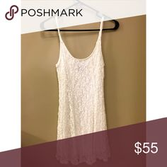 Ivory Lace Scoop-Neck Dress Ivory Lace Dress Scoop-neck/scoop-back Looser fit, but still defines shape Can be dressed up or dressed down  New NO TRADES, thank you   54% Nylon/41% Viscose/5% Spandex Lining 100% Polyester City Triangles Dresses Mini