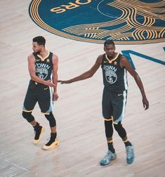 Stephen Curry and Kevin Durant of the Golden State Warriors celebrate after the game against the Celtics on January 27 2018 at ORACLE Arena in Oakland...