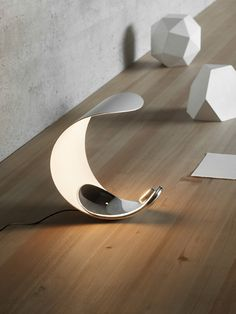 Constructed with modern materials, Curl from #LucePlan is perfect for providing adjustable ambient light in contemporary interior spaces  #modernlighting #moderninteriors #moderndecor #homedesign #decor #interiors #interiordecor