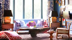 Tour Brian Patrick Flynn's Lively, Retro Cali Bachelor Pad with textured carpets, plaid pillows, patterned chairs, floral curtains and a maximalist gallery wall.