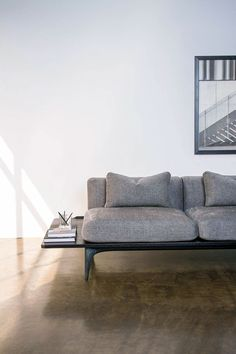 In keeping with the architectural inspiration our Salk sofa is a unique, contemporary industrial design, that features incorporated side tables in solid oak. Its clean lined silhouette, modern styling of concrete and oak makes it an ideal accent for any r…