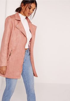 Say holla to the new season in this biker jacket. In a dusky pink hue, 70's style bonded faux suede, zip deets, a satin lining, and a longline biker style, we're styling with a plain jersey, denim and barely there heels for a smart casual f...