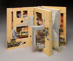 A Short Course in Recollection by Susan Collard. Alphabet blocks and clock parts, fragments of children's tales and 19th-century machinery merge in an intricate toy. When the book is set up and placed in motion, steel balls roll and clatter through a series of ramps, toggles, and switchbacks.