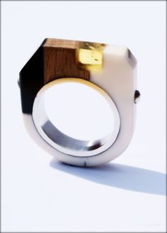 Ring by EnigmaG9. Resin, reclaimed wood, buffalo horn, Baltic amber and stainless steel.