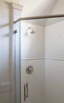 Simple, but classy. Subway tiles with molding and then tiles on the diagonal above chair rail height dental molding. 1