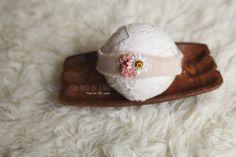 A soft, angora headband embellished with pink moss, a dried daisy, and a pearlNewborn size