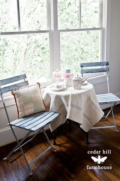 French-bistro-chairs-and-little-table-by-window #frenchdecor