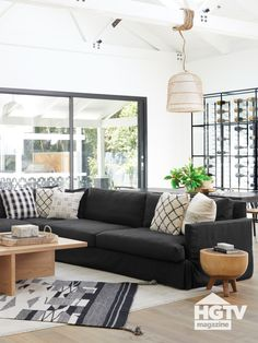 Christina Anstead's living room is decorated with a blond wood coffee table, low-slung armchairs and a wine rack. Take a full tour. Wood Furniture Living Room, Table Decor Living Room, Living Room Sectional, Living Room White, Boho Living Room, White Rooms, Black Sectional, Black And White Living Room Ideas, Black Couches