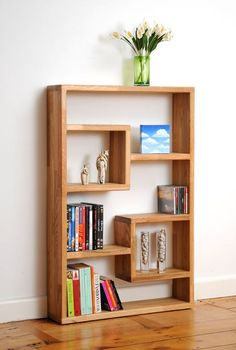Wise feng shui bookshelf flow...heavy books towards the bottom...beautiful images towards the middle...blossoming flowers at the top. Great!