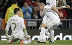 Real Madrid's Cristiano Ronaldo from Portugal, left, celebrates after scoring, with teammate Pepe from Portugal during a Spanish La Liga soccer match against Sporting Gijon at the Santiago Bernabeu Stadium in Madrid, Spain, Saturday, April 14, 2012. (AP Photo/Alberto Di Lolli)