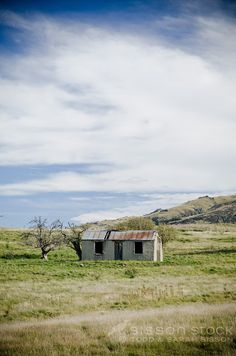 Historic cob cottage in field near central Otago Central Rail Trail at Hyde New Zealand.