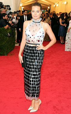 Margot Robbie wears an organza tea-length dress by Prada that features a sheer top over a satin bralette to the 2014 Met Gala Celebrity Red Carpet, Celebrity Style, Celebrity News, Celebrity Photos, Margot Robbie Style, Satin Bralette, Prada Dress, Met Gala Red Carpet, Nyc