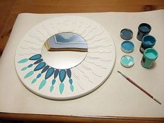 IKEA lazy susan, round mirror, and woodsies... good possibilities here.