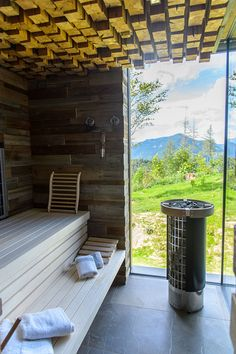 This rustic modern chalet has a sauna with a wood block ceiling and large windows, for ultimate relaxation. Spa Design, House Design, Sauna Hammam, Austria, Ceiling Texture, Rural Retreats, Old Farm Houses, Window Design, House And Home Magazine