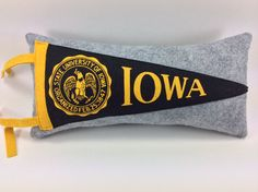 Great gift for football fan or alumni. University of Iowa Hawkeyes Vintage Pennant Pillow by MimiGriffithDesigns,