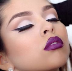 the perfect girls' night out look - pale pink eye shadow with a straight cat liner and a purple lip