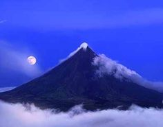 Mayon Volcano in Bicol Philippines--still very active as seen by the smoke coming from the top. photo by Per-Andre Hoffmann