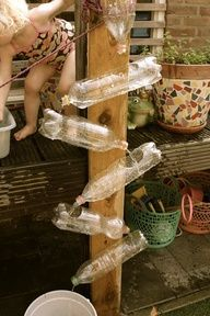 recyled plastic bottles become a waterwall. Could easily decorate these with any theme. Use spray paint, etc