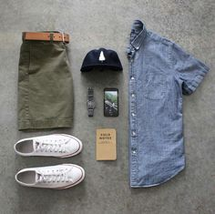 Light blue denim button-down shirt, olive green shorts, white sneakers
