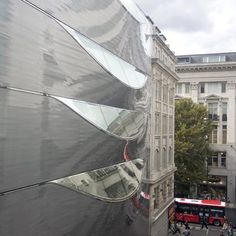 """10 Hills Place by Amanda Levete Architects //   """"Amanda Levete Architects has harnessed high quality ship hull technology to create an ingenious sculptural facade for a new office building just off London's Oxford Street.  Lack of daylight in the narrow streets around this major retail artery was a key issue. Inspired by the art work of Lucio Fontana, AL_A slashed the aluminium skin with large glazed areas orientated towards the sky to maximise and channel natural light into the office…"""