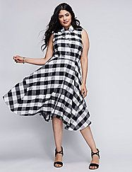 The gingham plaid gives this Julia Jordan shirtdress a vintage feel. But that full, handkerchief skirt? Totally now (and a total must-have). Pockets. Hidden side zipper. Lined. lanebryant.com