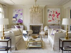 A monochromatic palette showcases boldly colorful art and accents. John Saladino sofas upholstered in Nancy Corzine silk canvas. Side tables, Suzanne Kasler for Hickory Chair. Coffee table, Jan Showers. Antique recamier from Herringbone Home. Chandelier, Nancy Corzine. Rug, Beauvais. Artwork, Aaron Wexler.