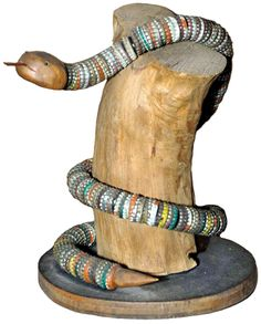 Bottle cap snake, early Twentieth Century, found in a private collection in Maine; wood, metal, pigment, 13½ by 12½ by 11 inches.