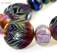 Beautiful lampwork beads by radiantmind on Etsy