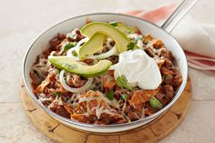 You may never make hamburgers again when you see what ground beef can do in this cheesy, creamy, zesty Beef Chilaquiles recipe.