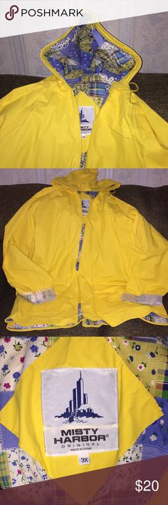 Misty Harbor Raincoat Make your own sunshine on a rainy day. Women's Misty Harbor yellow raincoat. Never worn, still has tissue on the sleeves. Blue patchwork inside of jacket. Jackets & Coats