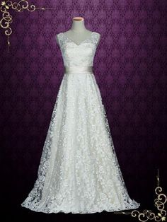 Classic lace wedding dress with flattering a-line skirt and v neckline. Photoed in champagne. This dress can also be made in all ivory or another color of your choice. Working Time: 8-10 weeks Rush Or