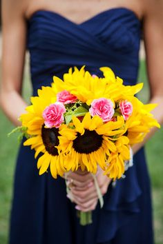 I keep coming back to the navy and sunflower theme! Love it, so fun and bright for a spring wedding!
