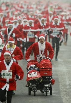 Hundreds of people dressed as Santa Claus start the annual St. Nicholas Run, in Michendorf, Germany, Dec. 9.
