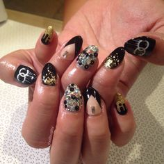 Dripping Chanel logo nail art with Swarvoski crystals. All nail art by MiMi at Vanity Projects, NYC. #vanityprojects  #nailart #chanel #gelmanicure #drippingchanellogo