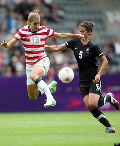 Alex Morgan, airborne. punching someone in the face. classic.