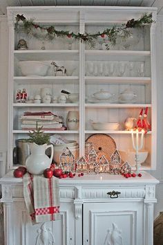 I LOVE Scandinavian style Christmas decorating.  It's pure perfect with a white backdrop for gingerbread houses and red holiday accents.