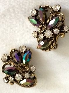 A personal favorite from my Etsy shop https://www.etsy.com/listing/233458282/vintage-rhinestone-clip-earrings-black
