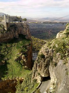 The suspended bridge in Constantine, Algeria (by yacinetig).  ...and a road thru the mountain!  no.