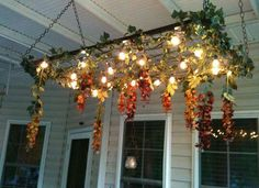Outdoor Chandelier  Once the baby grows out of her crib, you can remove the metal spring support and use it for a variety of purposes—it can even serve as the framework for an outdoor chandelier of twinkle lights. Weave in some vining plants to bring a romantic ambience to a screened-inporchor patio.