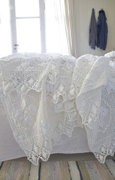 Crochet lace bedspread...lovely!   My precious mom crocheted many of these - they were so beautiful - wished I had one right now!